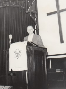 Luke Buttry preaching at First Baptist Church of Shenandoah, Iowa, 1970s.