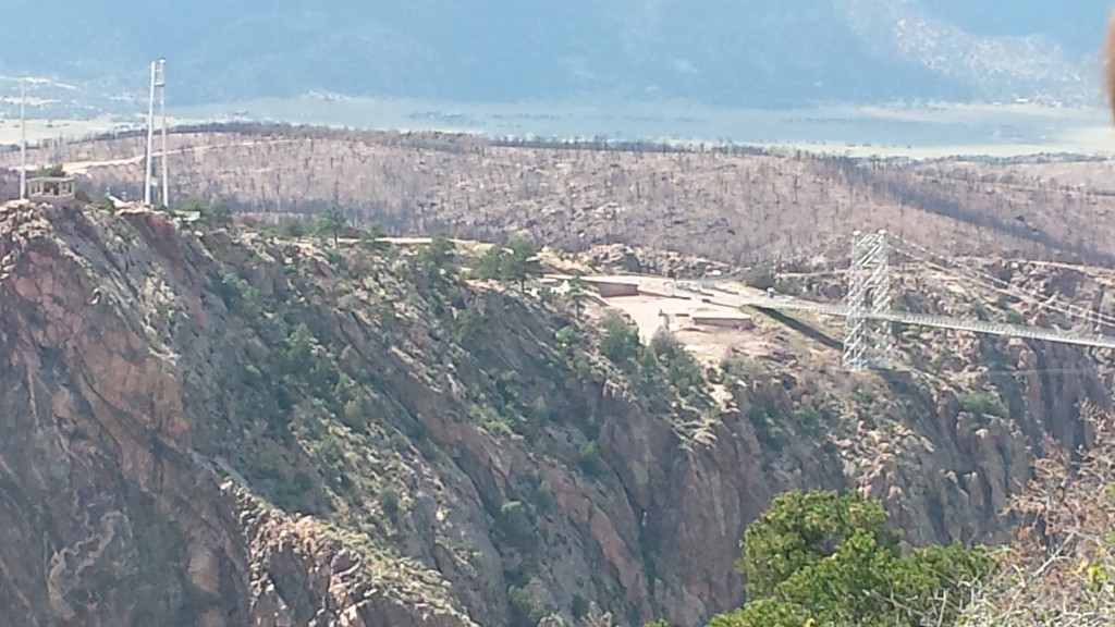 After riding the train through the canyon, we drove up to the rim. Royal Gorge Bridge and park were closed because of damage from wildfires. We could view the bridge and the gorge from one overlook that was open. You can see the burnt trees beyond the bridge.