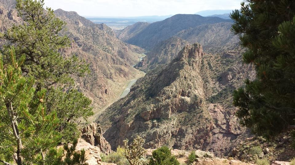 The Arkansas River and the Royal Gorge Route Railroad from above on the approach to the gorge.