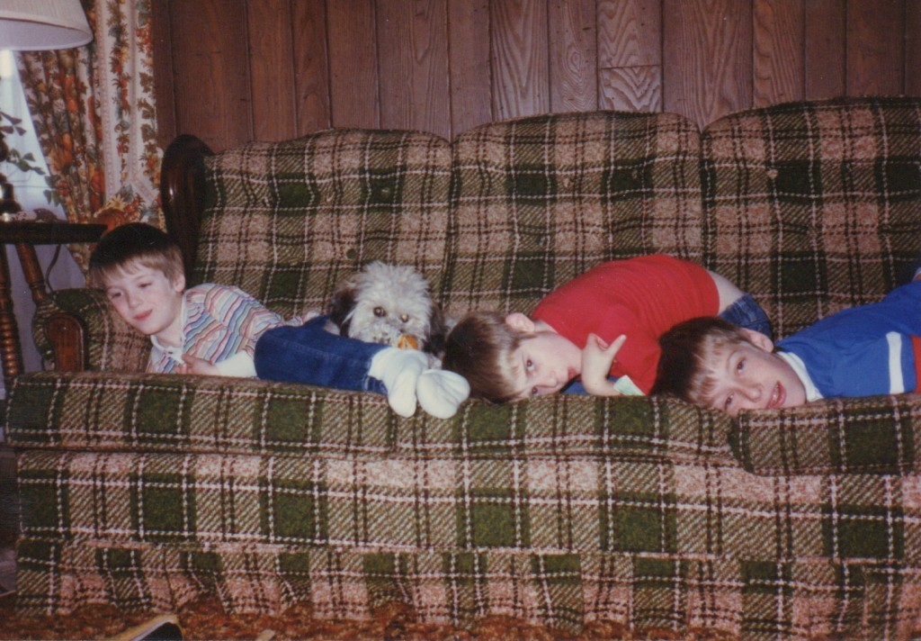 Tom, Joe and Mike on the couch in our Shawnee family room with Cocoa, the poodle mix who moved with us from Kansas to North Dakota to Nebraska.
