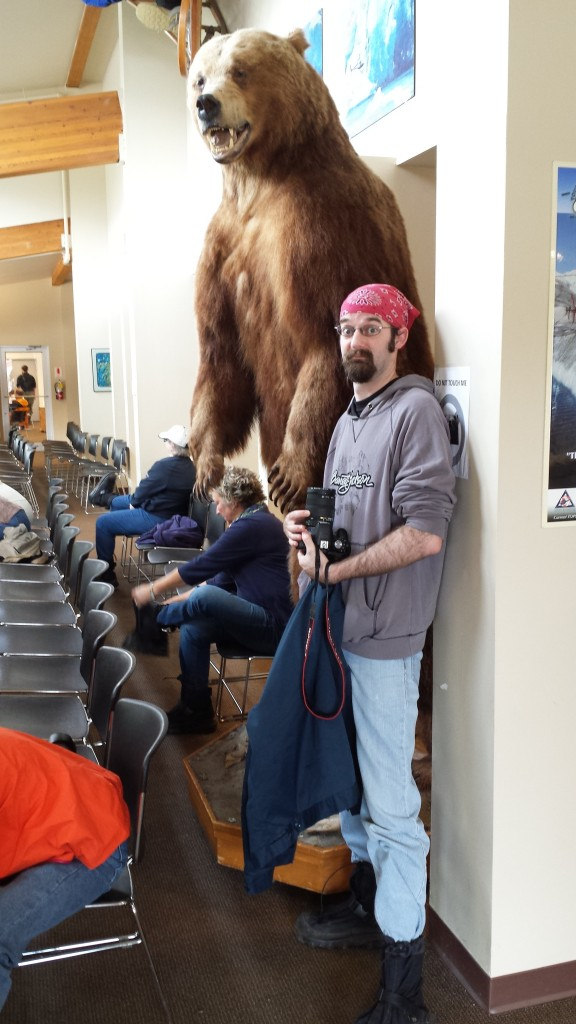 "We didn't see this bear in the wild, just at the heliport. But it gives you an idea how big they can be. Joe's about 6'4""."